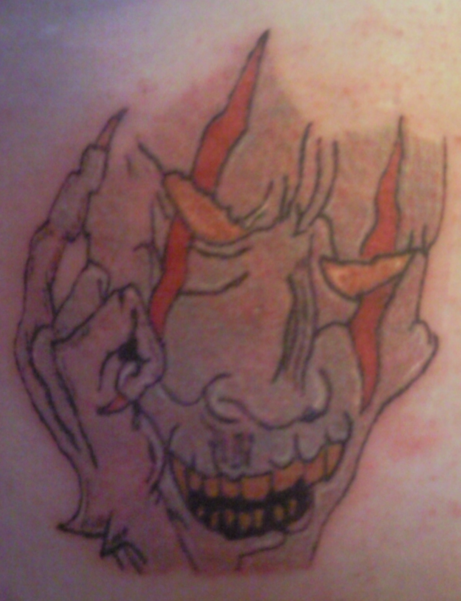 tattoo of demon on my stomach