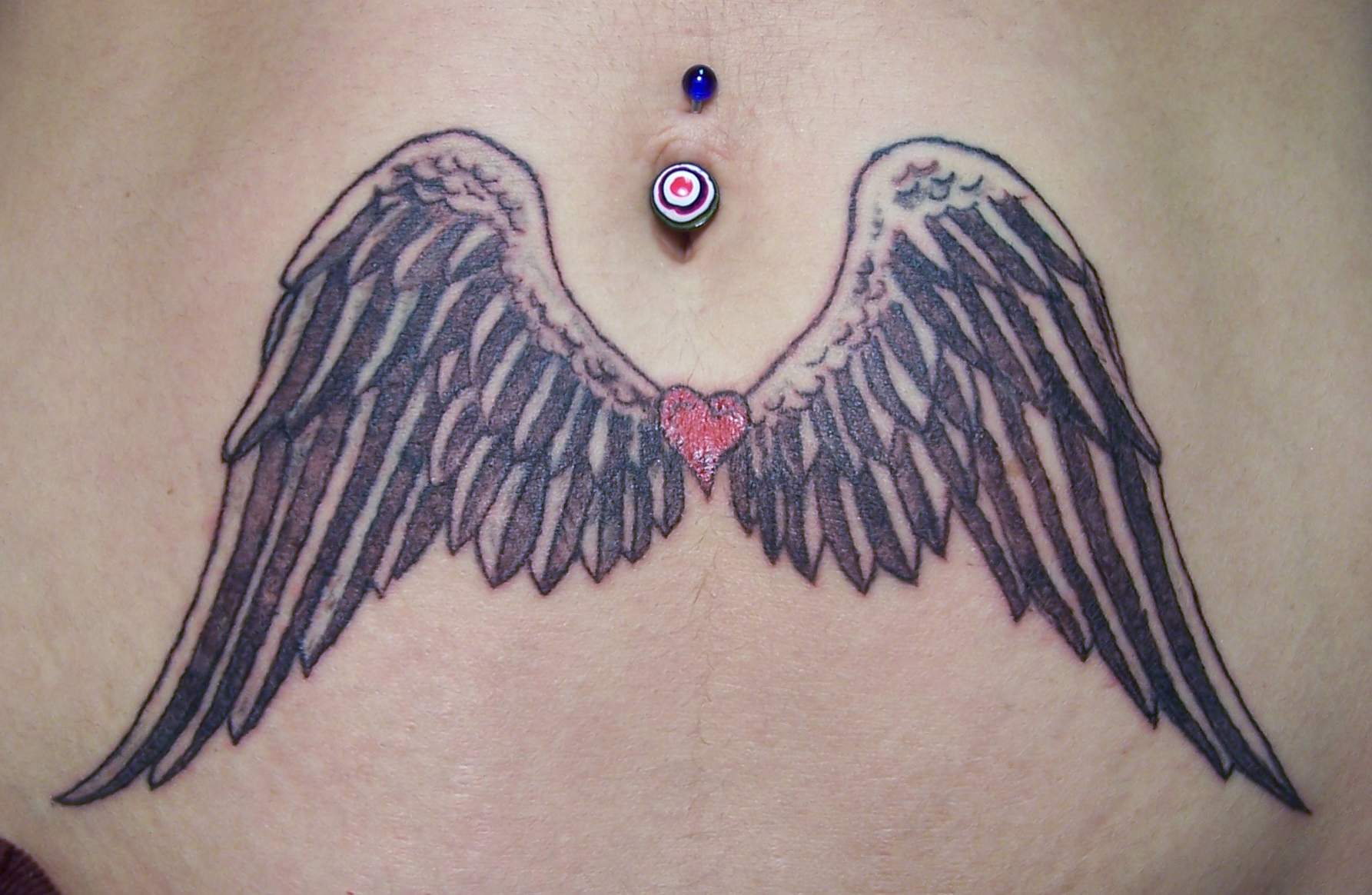 Angel Wings On Stomach Tattoo