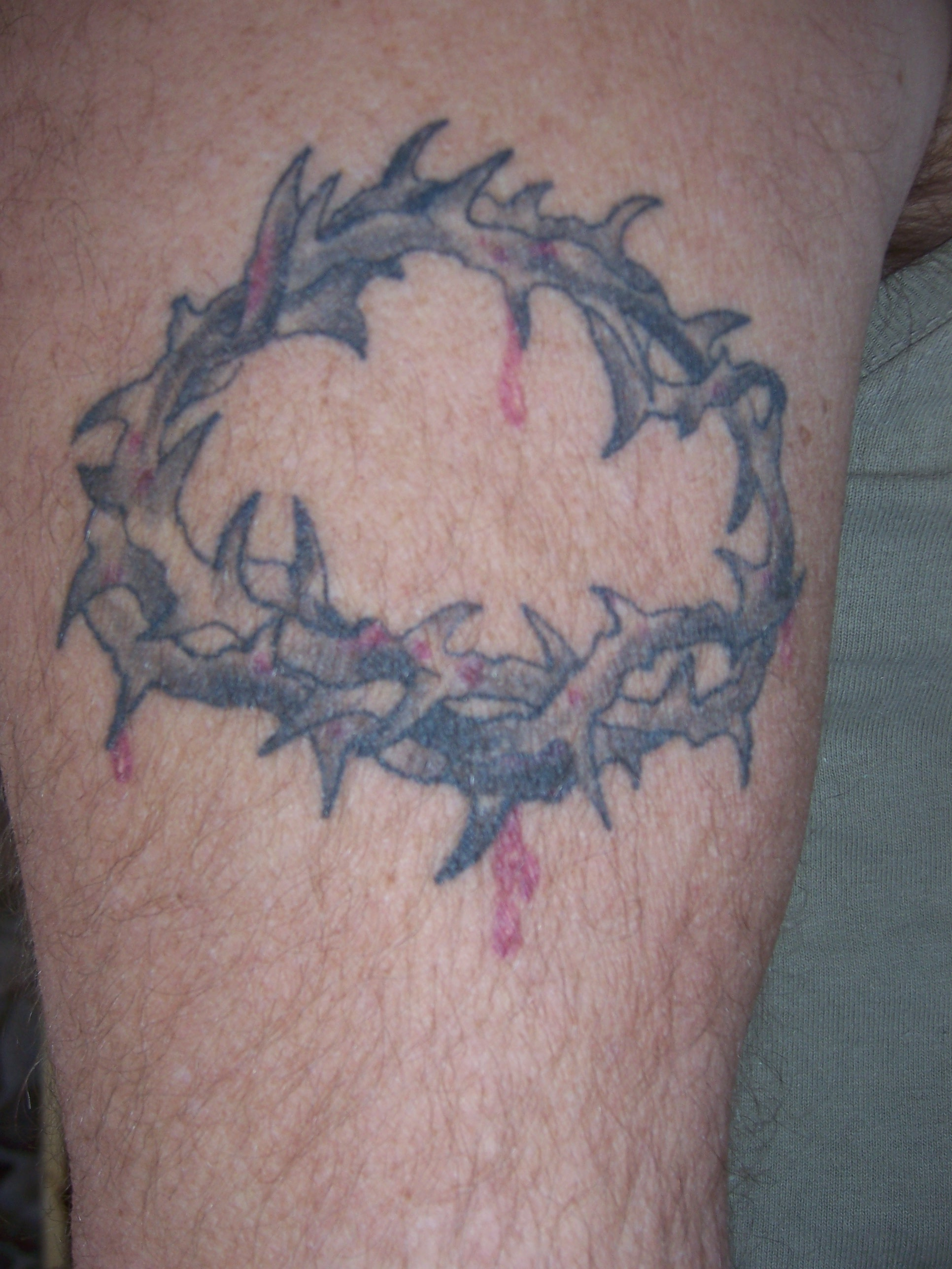 Crown of thorns wrist tattoo