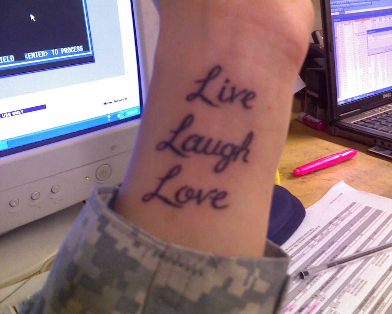 Live, Laugh, Love on wrist