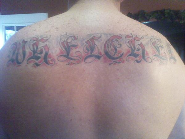 Last name across back tattoo picture for Last name tattoos on back