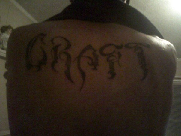 Last name on back tattoo picture for Last name tattoos on back