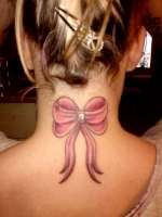 Bow Tattoo With Dermal Anchor Piercing