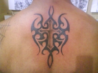 tribal cross on te back