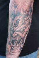 Demon with slipknot symbol